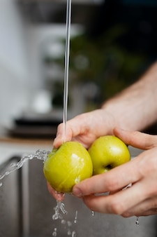 Close up hands washing apples