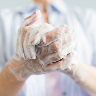 Close-up of hands with soap and foam