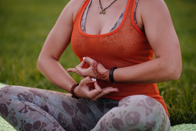 Close-up of the hands of a young girl who does yoga. healthy lifestyle