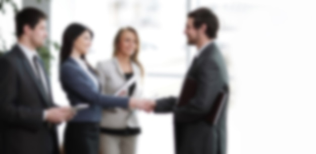 Close up. handshake business partners in a modern business center