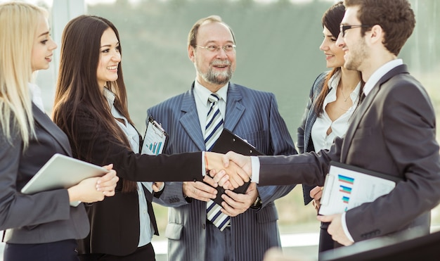 Close up on handshake financial partners, and attorneys of the company