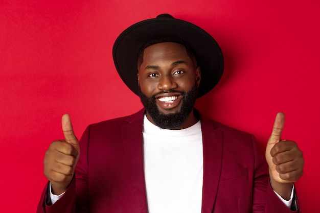 Close-up of handsome bearded black man showing thumb-up,