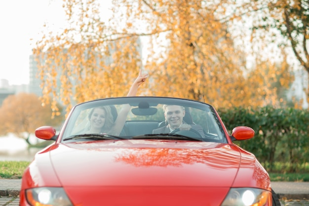Close up. happy bride and groom sitting in a luxury car.