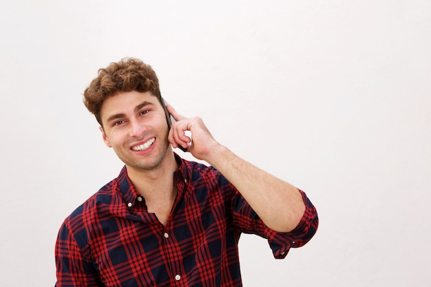 Close up happy casual man talking on smart phone
