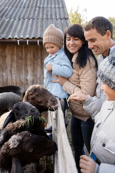 Close up happy family with animals