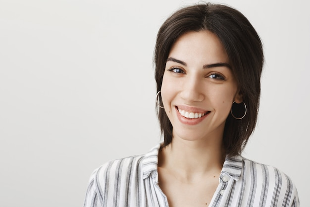 Close-up of happy gorgeous woman smiling with white teeth