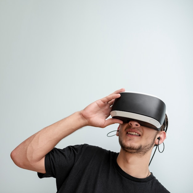 Close-up happy guy wearing vr glasses