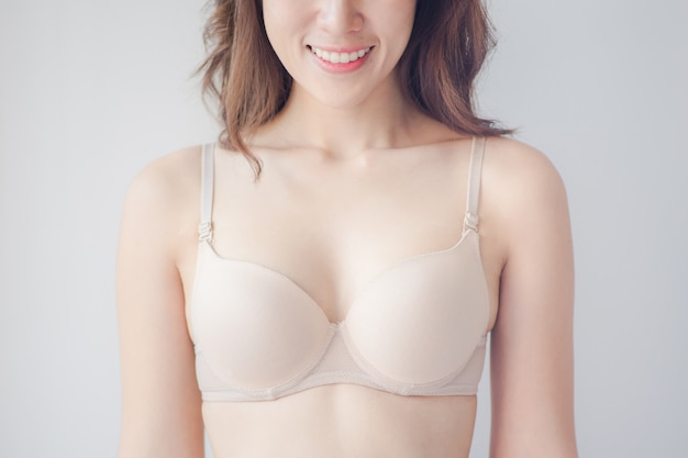 Close up of happy woman in underwear demonstrating her perfect body with silky smooth skin