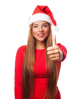 Close-up of happy woman with thumbs up