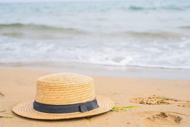 Close- up of  hat  on the beach