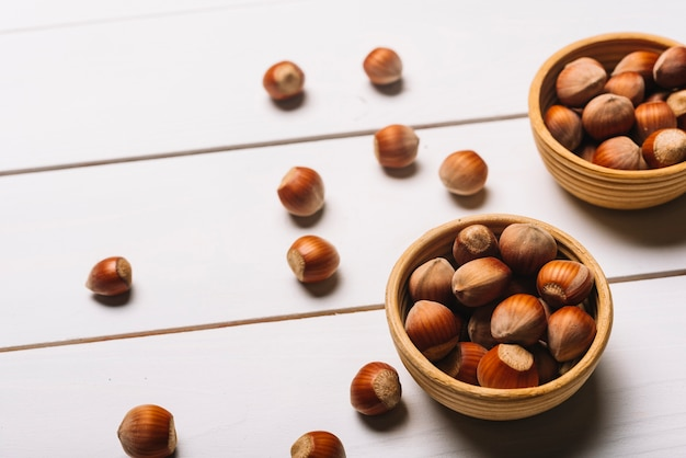 Close-up hazelnuts in bowls