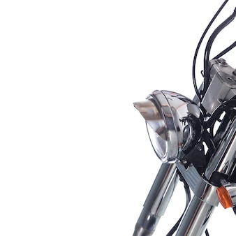 Close up of headlight on vintage motorcycle on white background