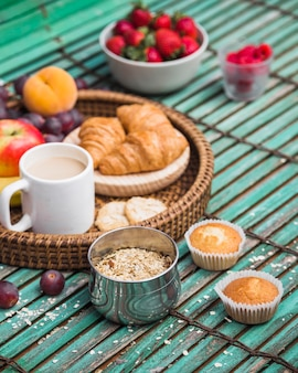 Close-up of healthy breakfast on wooden backdrop