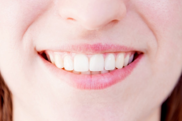 Close-up of healthy white teeth of smiling woman female