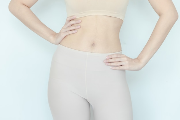 Close up of healthy woman show slim body
