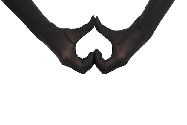 Close up of heart made by woman hands in black gloves isolated on white background.