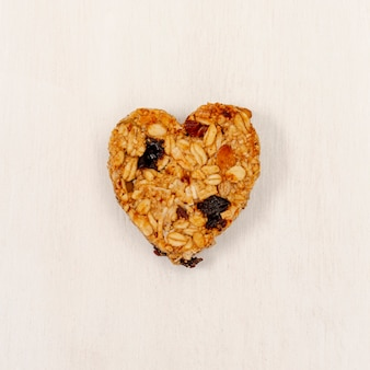 Close-up heart shape cereal with raisin
