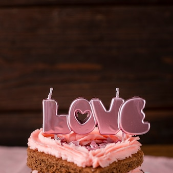 Close-up of heart-shaped cake slice with candles