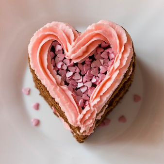 Close-up of heart-shaped cake slice with frosting