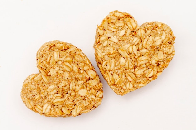 Close-up heart shaped cereal on white background