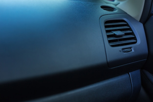 The close up of heating and air-conditioning unit on the classy black head unit of a new neat car