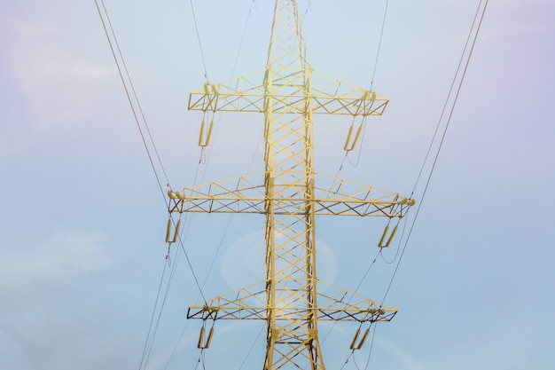 Close up of high voltage power line against blue sky