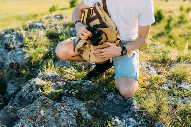 Close-up of a hiker holding binocular