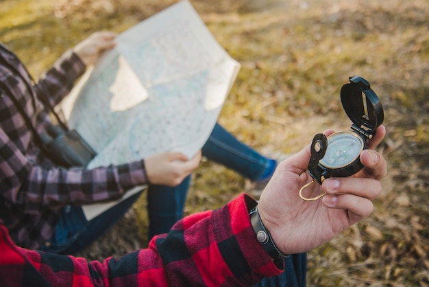 Close-up of hiker with a compass in his hand