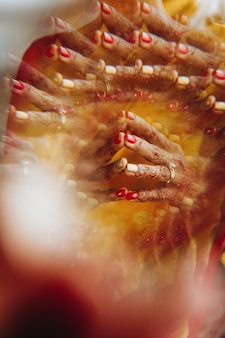 Close-up of hindu bride's hands covered with henna tattoos