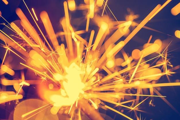 Close-up of holiday christmas sparkler on dark background