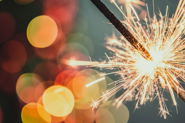 Close-up of holiday christmas sparkler on dark background