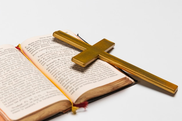 Close-up holy book and cross on table