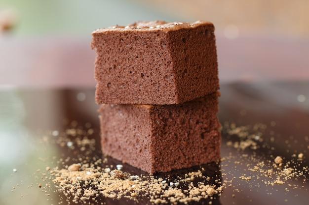 Close up homemade chocolate brownies in warn light