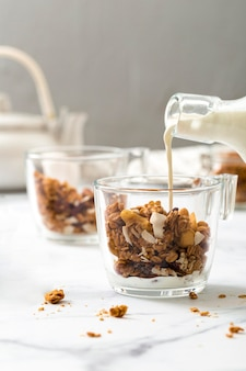 Close-up homemade granola with milk