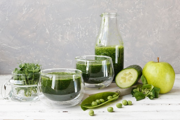 Close up of homemade green smoothie made from fresh spinach