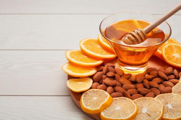 Close-up homemade honey with almonds
