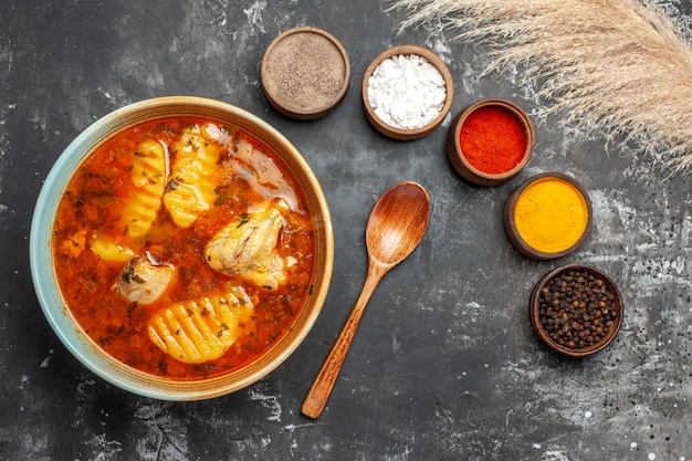 Close up on homemade soup with chicken and spices set