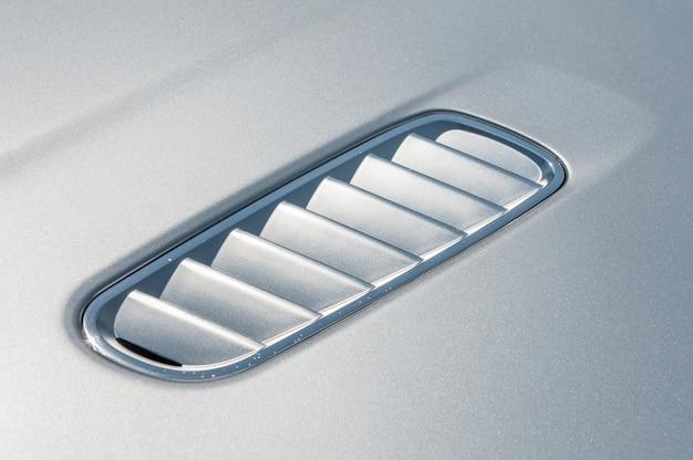 Close up of hood of a grey sport car