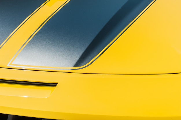 Close up of hood of a yellow sport car