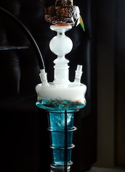 Close up of hookah with fruits in blue water