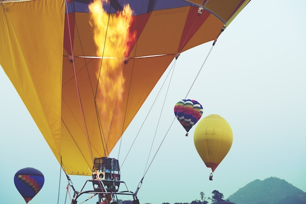 Close-up of hot air balloons with fire blue sky background applying retro filter effect
