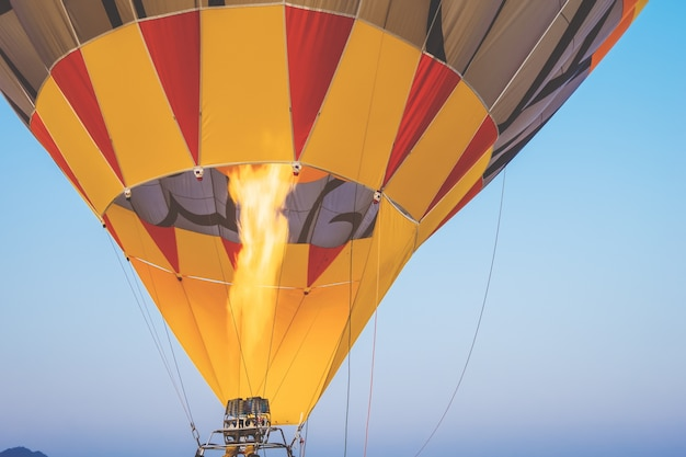 Close-up of hot air balloons with fire with sky background - retro and vintage filter effect styles.
