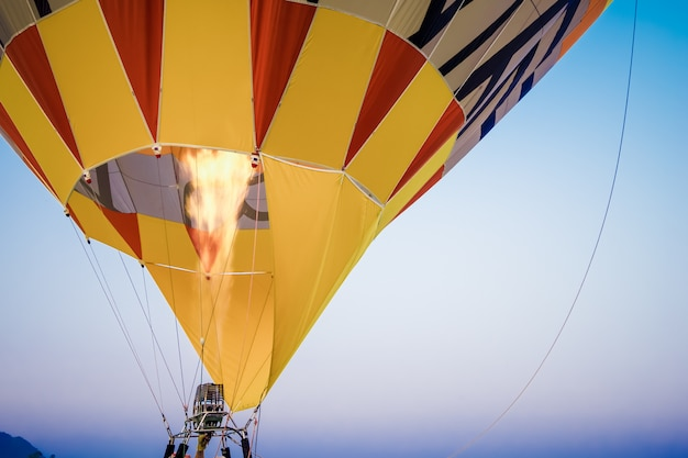 Close-up of hot air balloons with fire with sky background