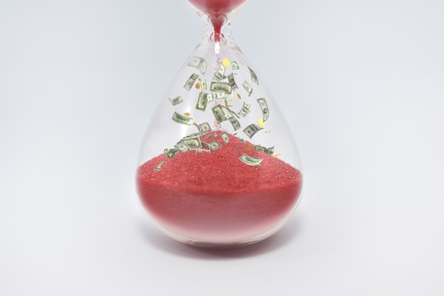 Close up on hourglass sandglass clock isolated