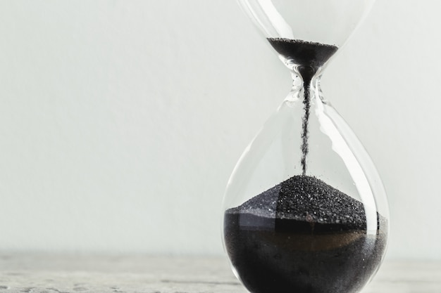 Close up hourglass on table