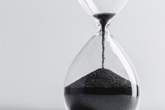 Close up of hourglass with black sand