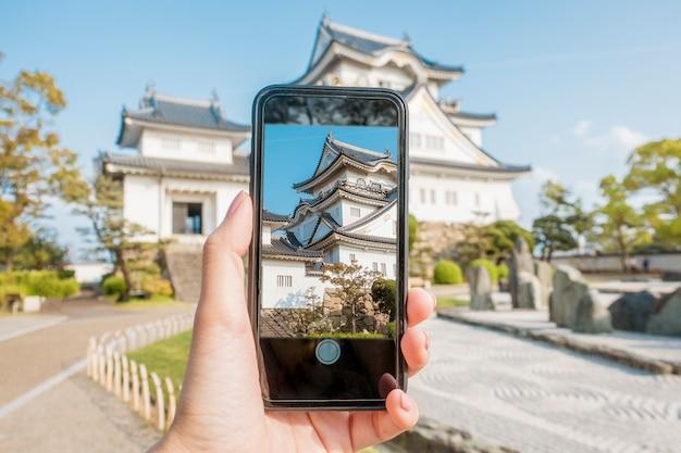 Close up human  hand is photograph kishiwada castle in kishiwada city, osaka