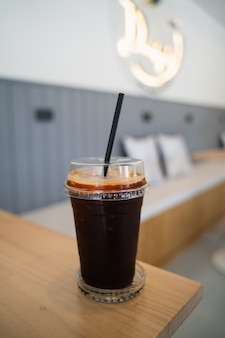 Close up of ice coffee on the wood table in the cafe