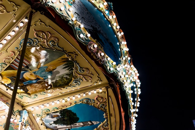 Close-up of an illuminated carousel ride under sky