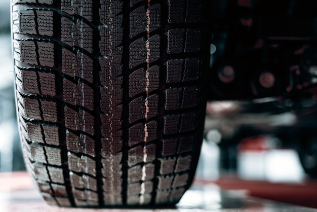 Close-up image of car wheel with black rubber tire